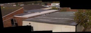 Image 1 – digital photo of a series of flat roofs at a school (the roofs are of differing materials and ages. To the naked eye, there appears to be a bit of standing water to the left of image.